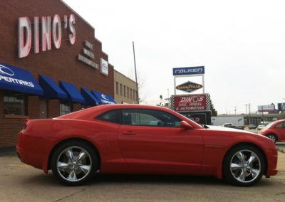 Red Camaro in front of Dino's