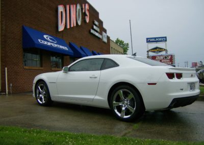 White Camaro in front of Dino's