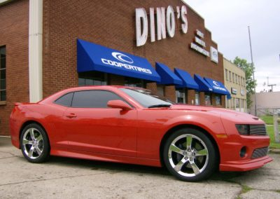 Red Car in front of Dino's